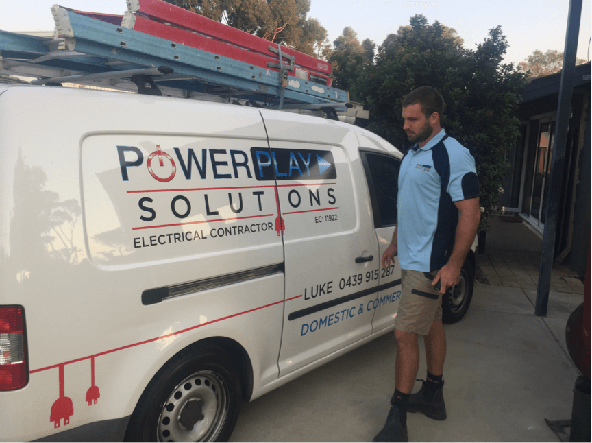 fremantle electrician in uniform next to his work van